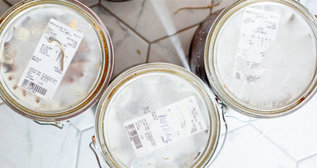 three gallons of paint